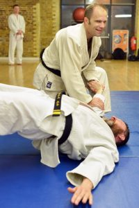 Hapkido class - two blackbelts doing martial arts techniques